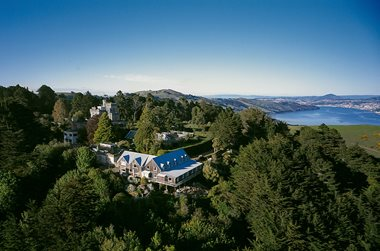 Larnach Lodge is situated on the grounds of Larnach Castle. Dunedin city can be seen down the harbour